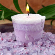 Purple candle and sea salt spa concept — Stock Photo