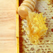 Foto Stock: Wooden box with natural honeycombs and honey