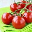Tomatoes Cherry fresh ripe on the kitchen towel — Stock Photo #5598945
