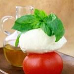 Traditional Italian Caprese salad tomato mozzarella cheese and basil — Stock Photo #5603118