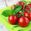 Tomatoes Cherry fresh ripe on the kitchen towel — Stock Photo #5609015