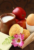 Breakfast with milk , boiled egg sesame buns and apple — Stock Photo