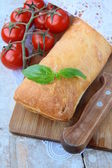 Traditional Italian ciabatta bread with tomato and basil — Stock Photo
