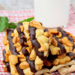 Homemade cookies with chocolate and nuts and a glass of milk — Stock Photo