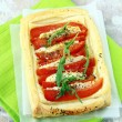 Tart of puff pastry with peppers and goat cheese vegetable appetizer — Stock Photo #5738086