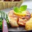 Red fish salmon grilled with lemon and salad - Stock Photo