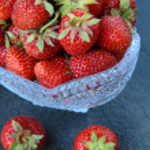 Antique glass vase with fresh tasty strawberries — Stock Photo