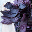 Red purple basil on a wooden table — Foto Stock