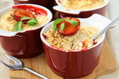 Crumble plum dessert with mint in a cup — Stock Photo