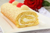 Biscuit roulade with cream and white chocolate — Stock Photo