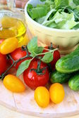 Ingredients for the salad, cucumbers, tomatoes, olive oil and green salad m — Stock Photo