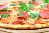 Fresh hot pepperoni pizza - closeup — Stock Photo