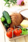Picnic basket, bread, cheese and vegetables — Stock Photo