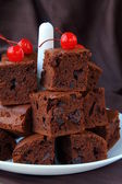 Brownie chocolate cakes with cherries on a brown background — Stock Photo