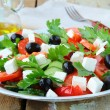 Royalty-Free Stock Photo: Greek salad with olives, tomatoes and feta cheese