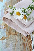 Bouquet of daisies on the linen bag on a wooden table rustic still life — Stockfoto