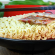 Instant  Asian noodle fast food with chopsticks in a red cup — Stock Photo
