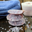 Spa still life .Bath lilac salt, towel and  candle — Stock Photo
