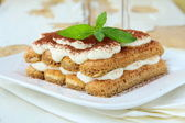 Traditional Italian dessert tiramisu on white plate — Stock Photo