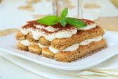 Traditional Italian dessert tiramisu on white plate — Stock Photo