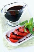 Fresh tomatoes basil and balsamic vinegar — Stock Photo