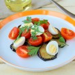 Salad with eggplant, tomato and quail eggs — Stock Photo