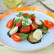Salad with eggplant, tomato and quail eggs - Stock Photo