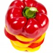 Slices of red and yellow bell peppers — Stock Photo