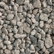 Many small grayish stones — Stock Photo
