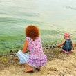 Mother and daughter on the bank — Stock Photo