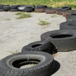 Stock Photo: Row of old tires
