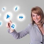 Woman pressing media player button — Stock Photo