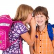 Foto Stock: Portrait of a blonde girl whispering in boy's ear
