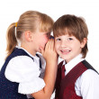 Two little kids telling secrets — Stockfoto