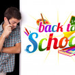 Student looking at back to school sign — Stock Photo