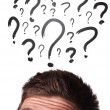 Caucasian male adult has way too many questions in his head — Stock Photo