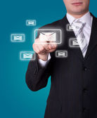 Man pressing e-mail icon — Stock Photo