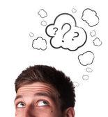 Männlichen erwachsenen hat viel zu viele fragen im kopf — Stockfoto