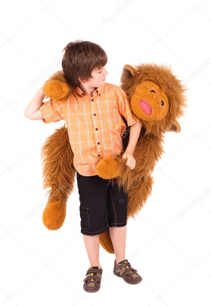 Little boy embraces a teddy bear, isolated on white — Stock Photo #5389843