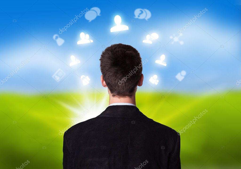 Young businessman with social network icons floating around his head 2 — Lizenzfreies Foto #5389912