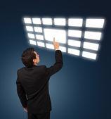 Man pressing touchscreen button — Stock Photo