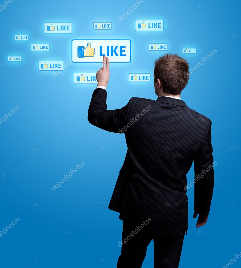 Businessman  hand pressing Social network icon — Stock Photo #5437054