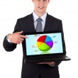 Business man pointing at a laptop computer with pie chart — Stock Photo #5445989