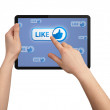 Hand pressing LIKE button in tablet pc — Stock Photo