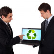 Business man show on laptop with recycle icon — Stock Photo