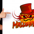 Stock Photo: Woman hand pointing to halloween sign