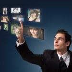 Man choosing photos — Stock Photo
