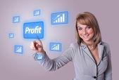 Woman pressing Profit button — Stock Photo