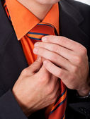 Detail of a man, fixing his tie — Stock fotografie