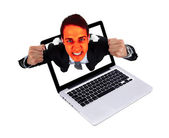 Angry man coming out from laptop — Stock Photo